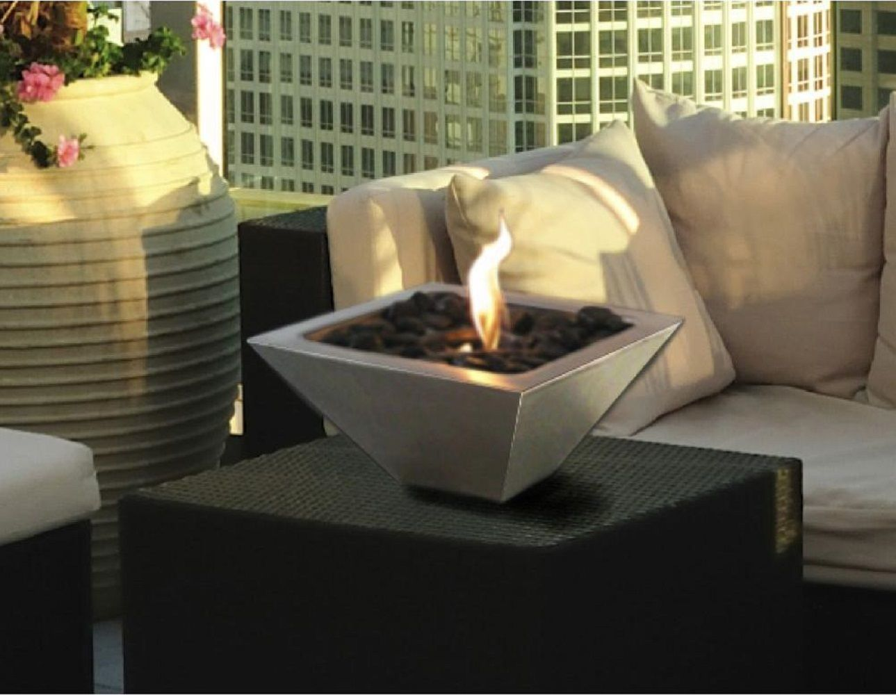 Now you don't have to sit around near a heater just to stay warm and cozy. The Empire model tabletop fireplace is a portable fireplace that you can move around at will. Put it on a table when you're indoors