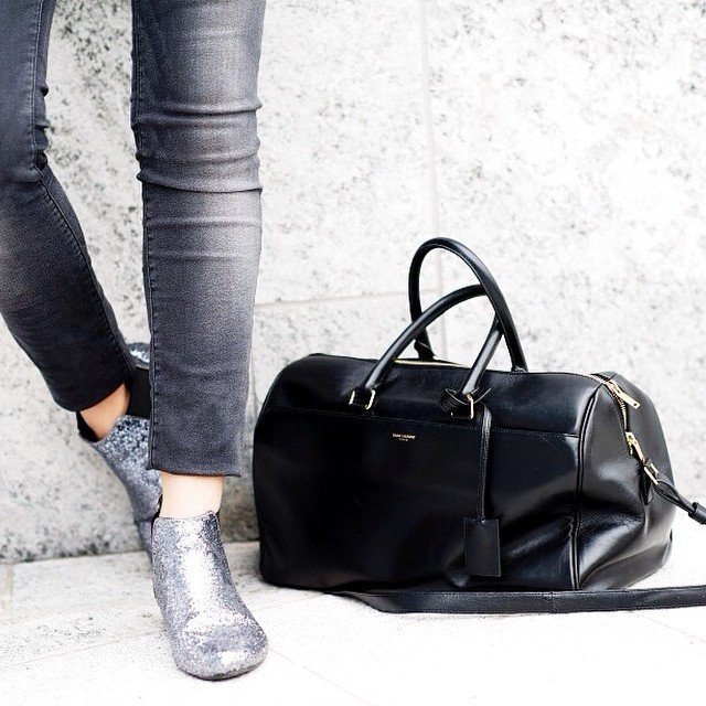 Flaunt the Italian style of black leather on your outdoor trips with this Classic 12 Hour Duffel by Saint Laurent.