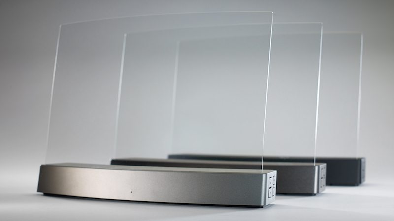 The Clio is a nearly invisible wireless speaker system conducting sound through a clear acrylic glass transducer.