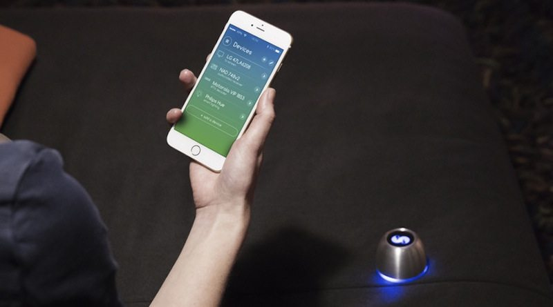 SPIN remote with app on couch