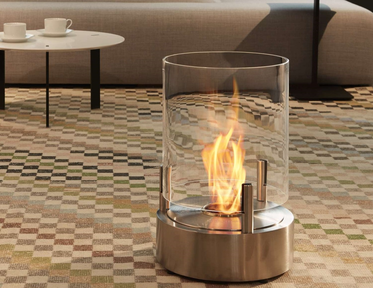 Weather resistant materials have been used behind the construction of the fully portable Cyl Outdoor Fireplace by EcoSmart Fire. Together with the round stainless steel base and the 3 litre stainless steel burner encased within