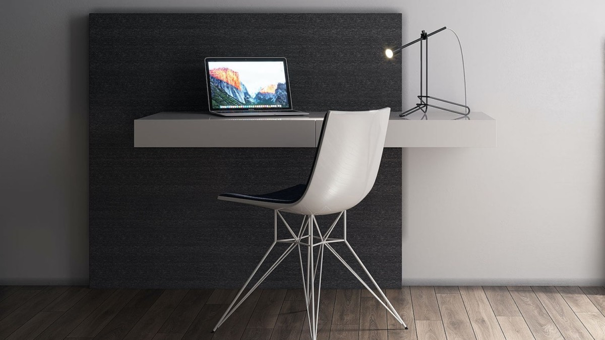 Walker Cantilever Desk by Modloft mounts on the wall for a floating look