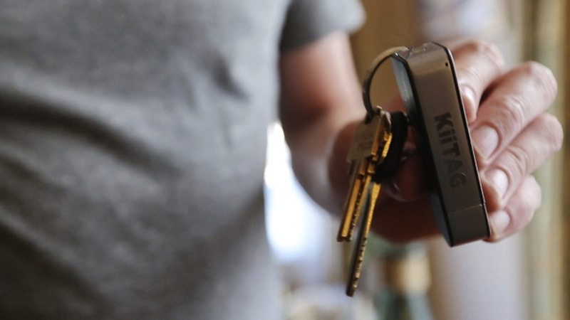 KiiTAG 2 as keychain being held by person