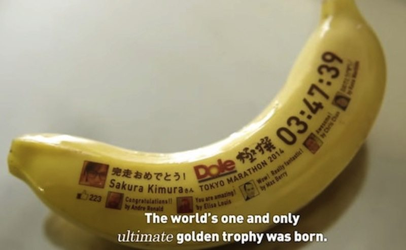 Dole edible wearable banana with sticker on table