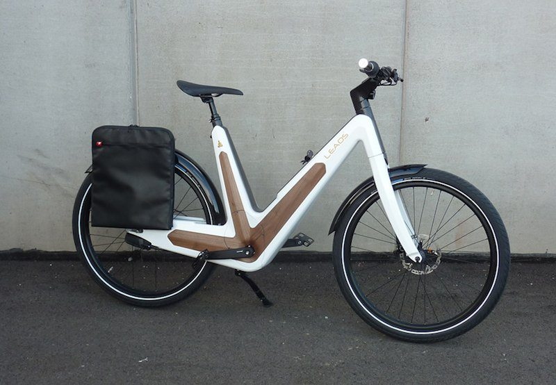 Leaos Solar Electric Bike white version equipped with messenger bag