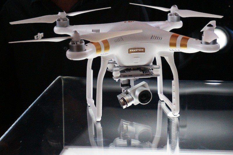 DJI Phantom 3 drone on clear stand