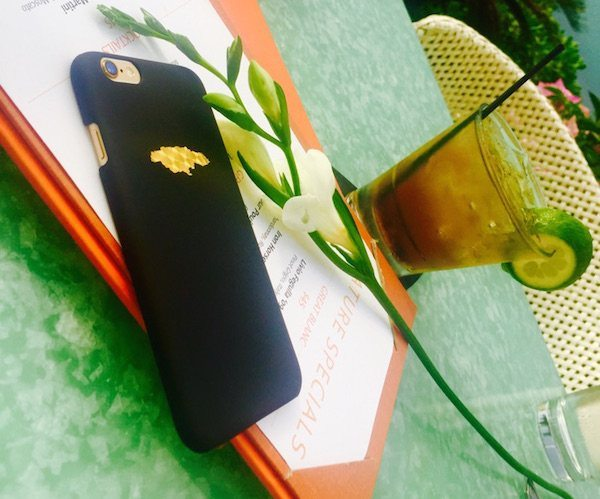 The Jamaican map has been beautifully depicted on the surface of the Golden Paradise iPhone Case by One Summer.