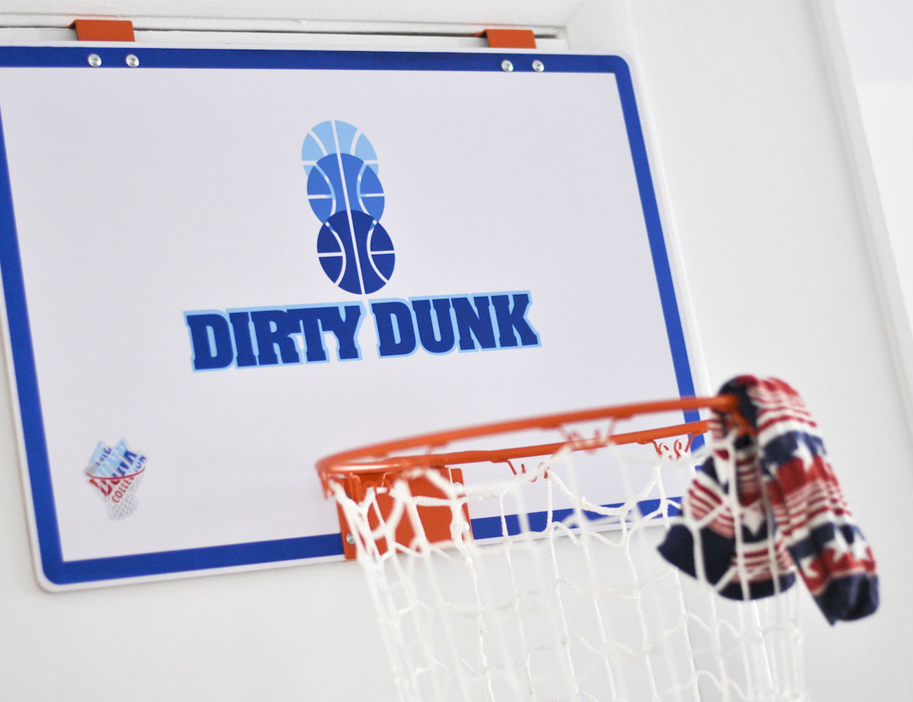The Dirty Dunk – The Original Over-the-Door Basketball Hoop Laundry Hamper