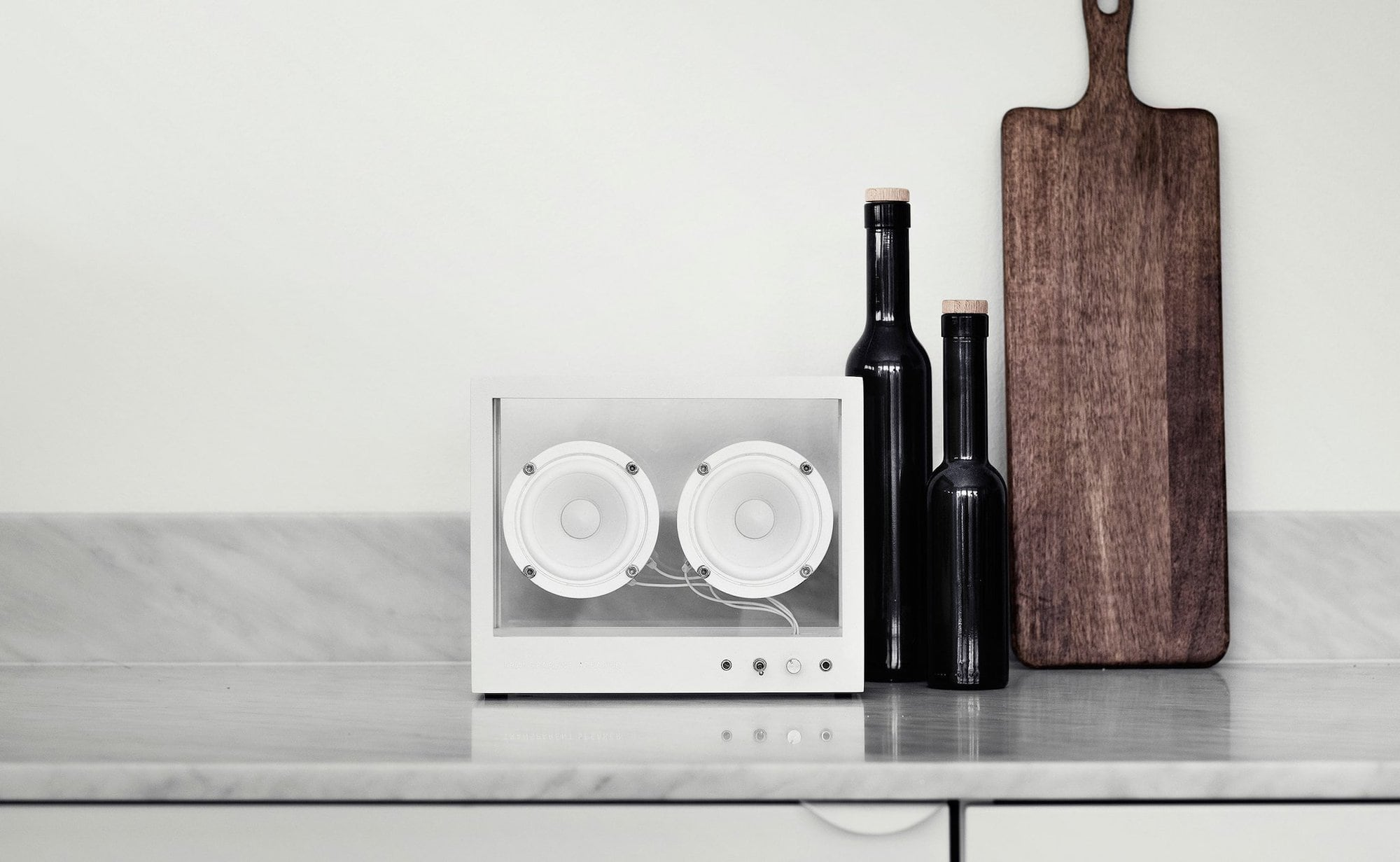 Small Transparent Aluminum and Glass Speaker is a minimalist, refined sound system