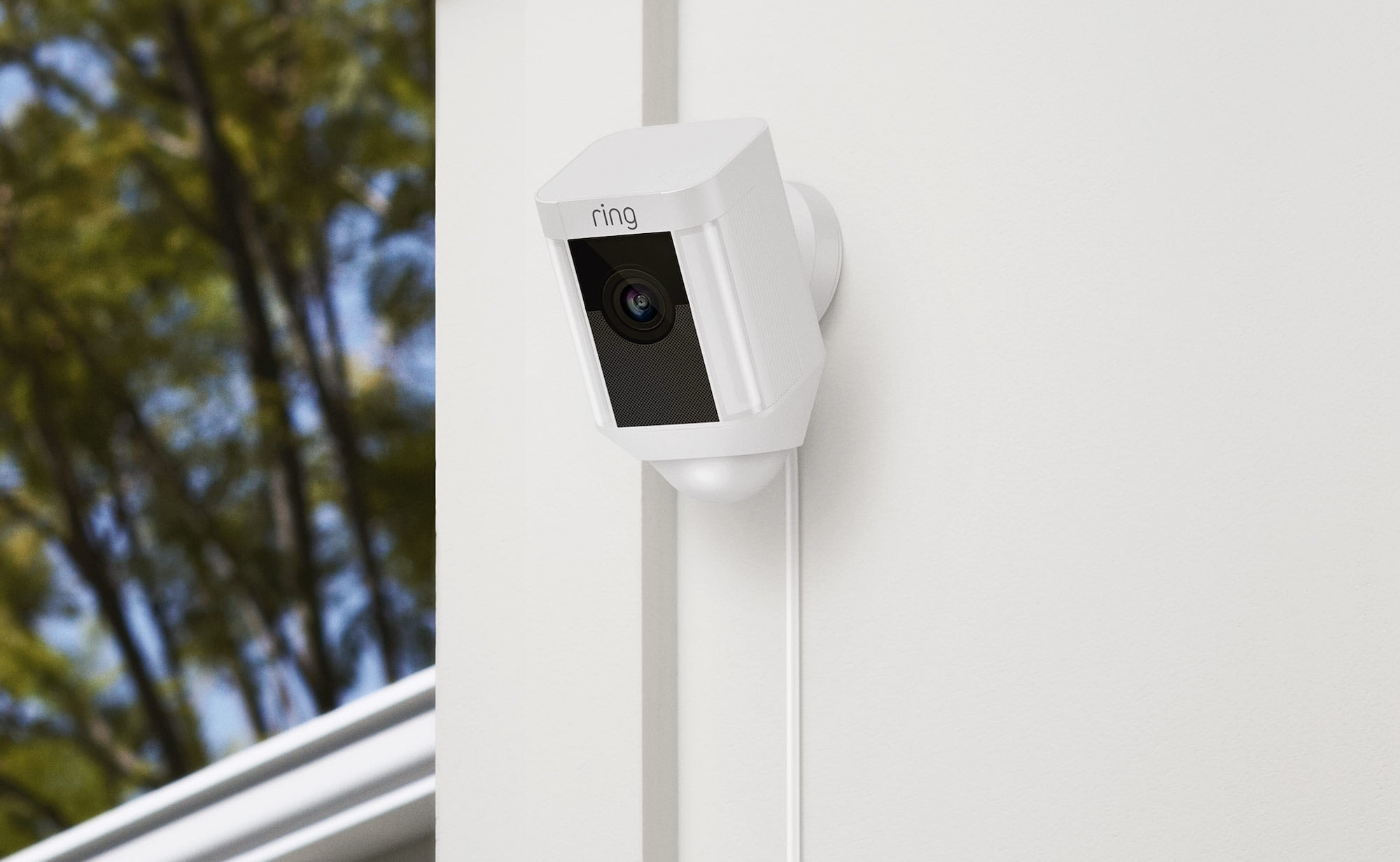 One of the wired and battery powered cameras is mounted on an exterior wall.