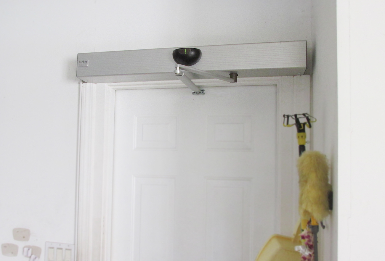 Tucker auto mation automatic swinging door gadget flow