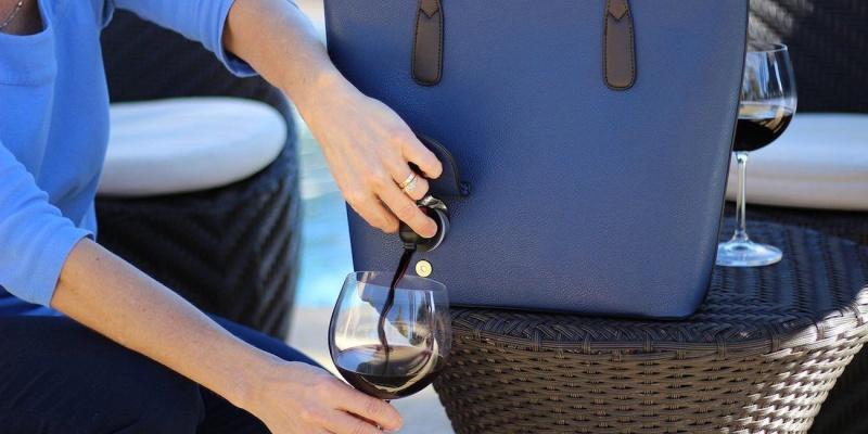 PortoVino Wine Dispensing Purse - Wine accessories that will make you reach for a glass