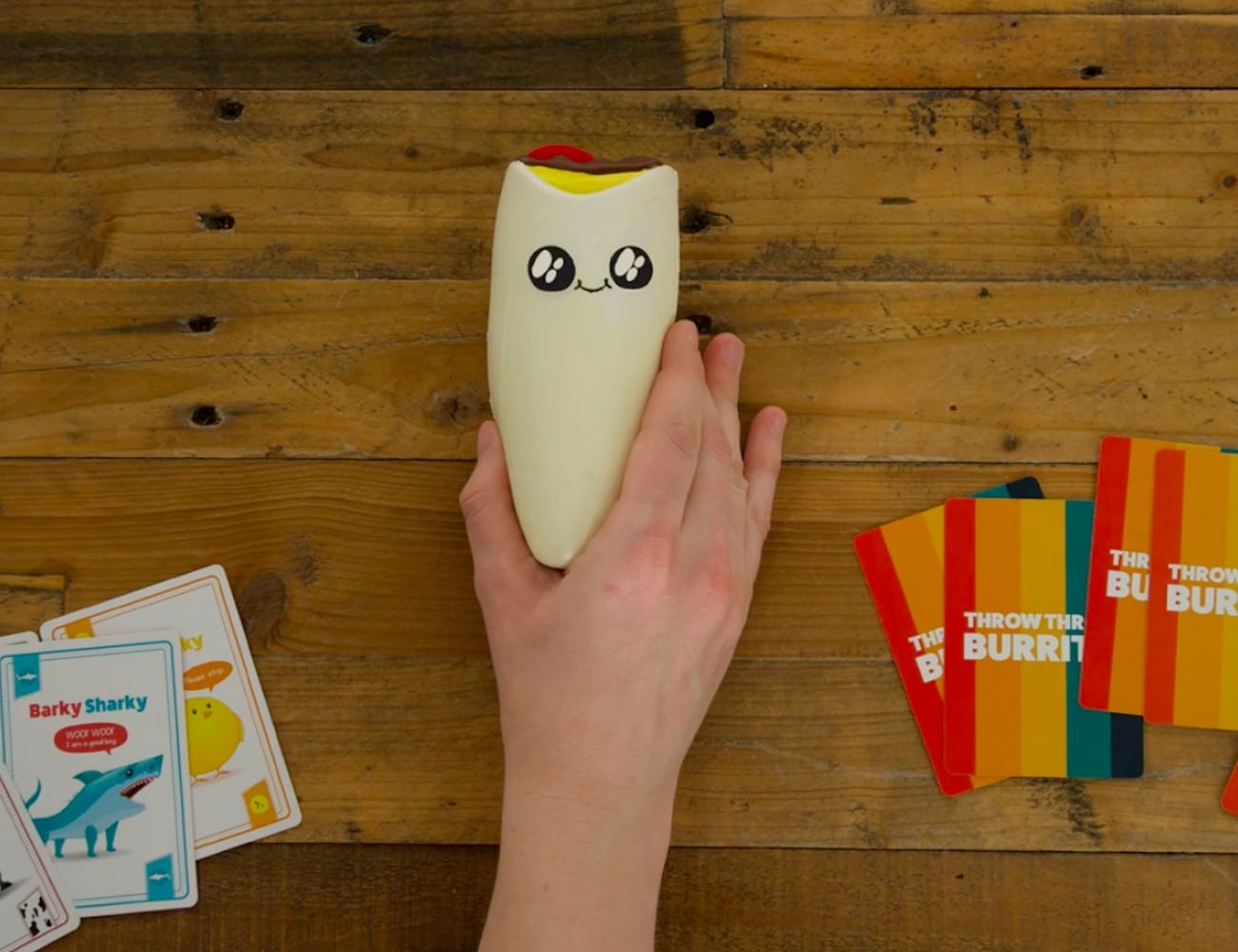 Throw Throw Burrito Dodgeball Card Game involves throwing stuff at your opponents