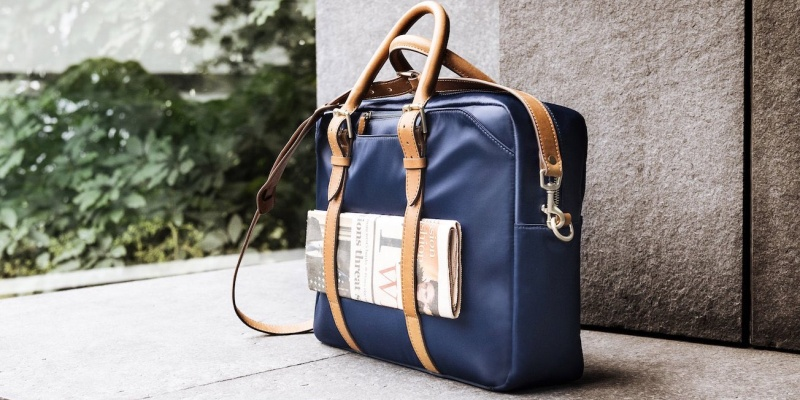Navy and Tan Cary Briefcase by Stuart & Lau - 8 Laptop bags that are sure to improve your daily commute