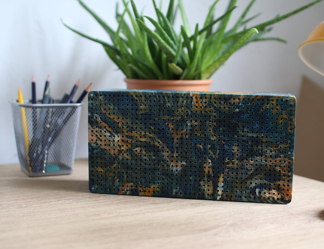 Gomi Hand-Marbled Recycled Plastic Speakers is made from plastic waste