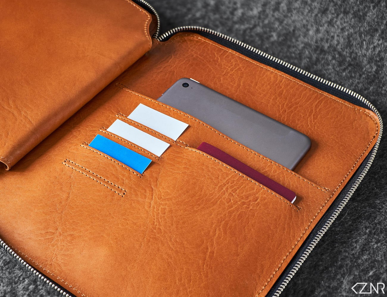 KZNR Minimalist Leather iPad Folio protects your iPad and more