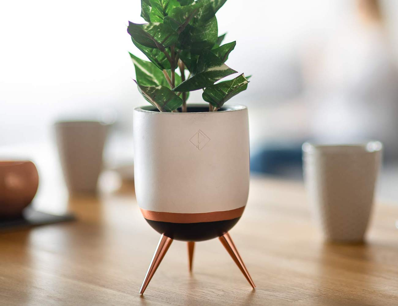 PERNER Tri-Legged Ceramic Flower Pot adds greenery to your space