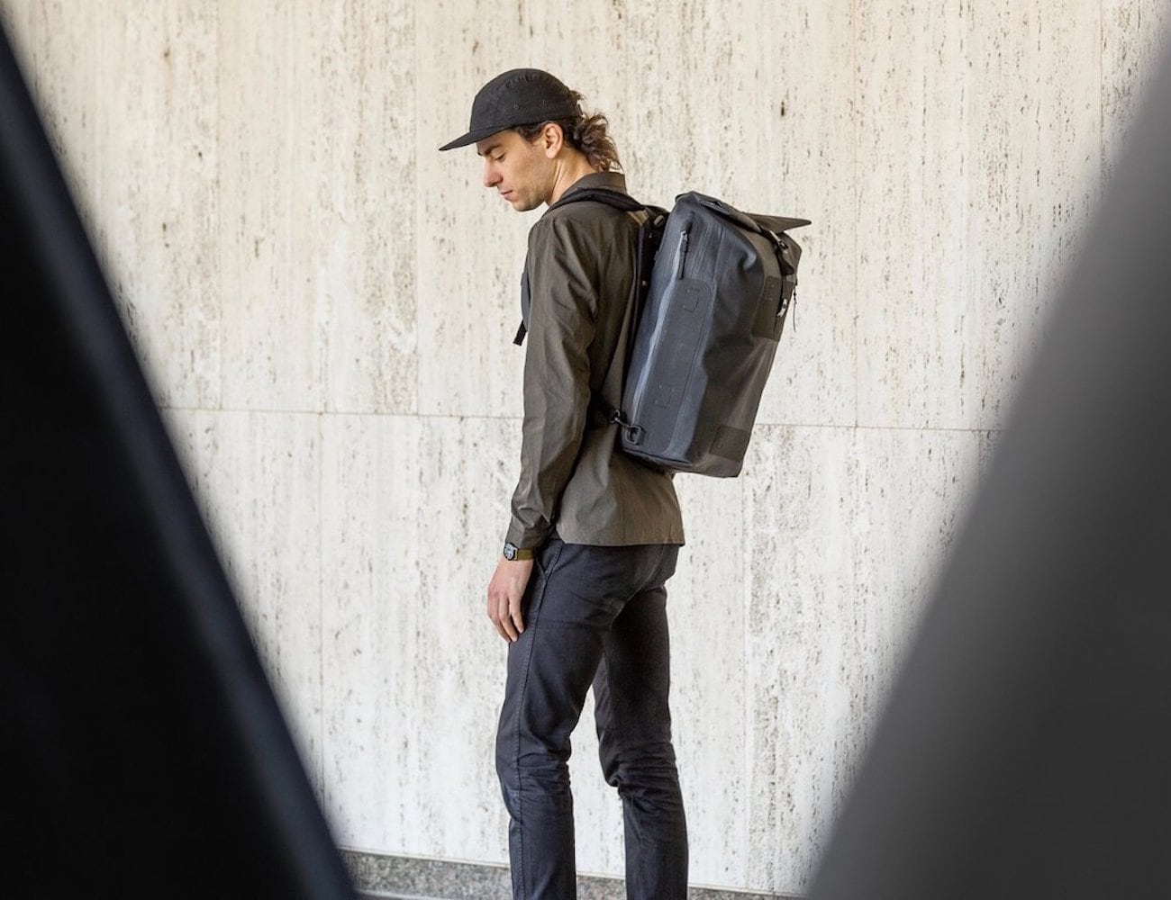 Black Ember WPRT MINIMAL waterproof roll top backpack protects your gear on the go