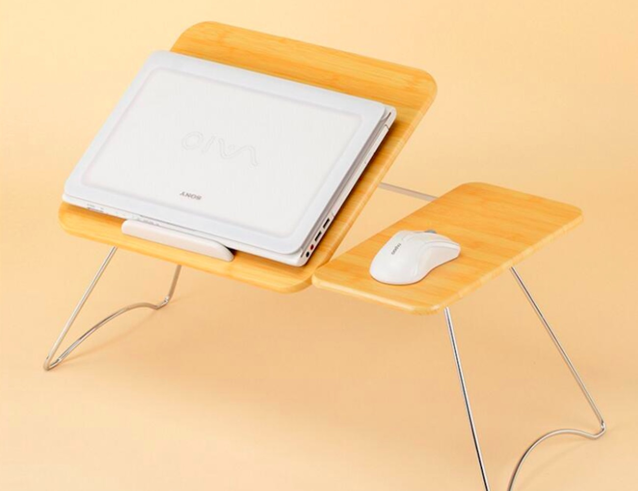 Portable Foldable Laptop Lap Desk puts your office at your fingertips