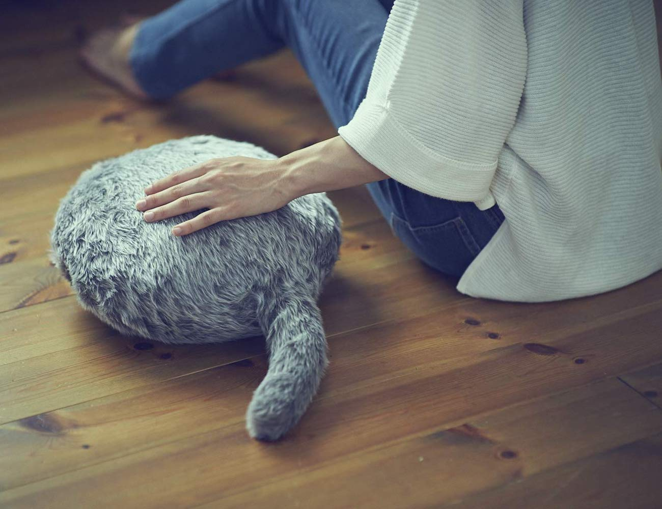 Qoobo Therapeutic Robot Pillow has a comforting, furry coat and tail