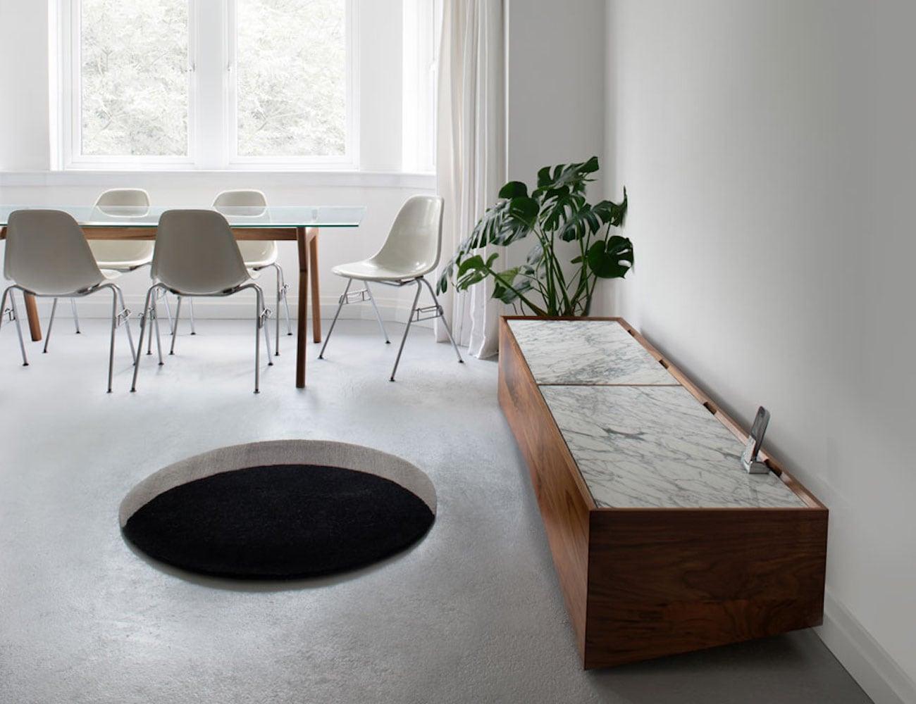 Round Void Wool Floor Rug creates the illusion of a black hole