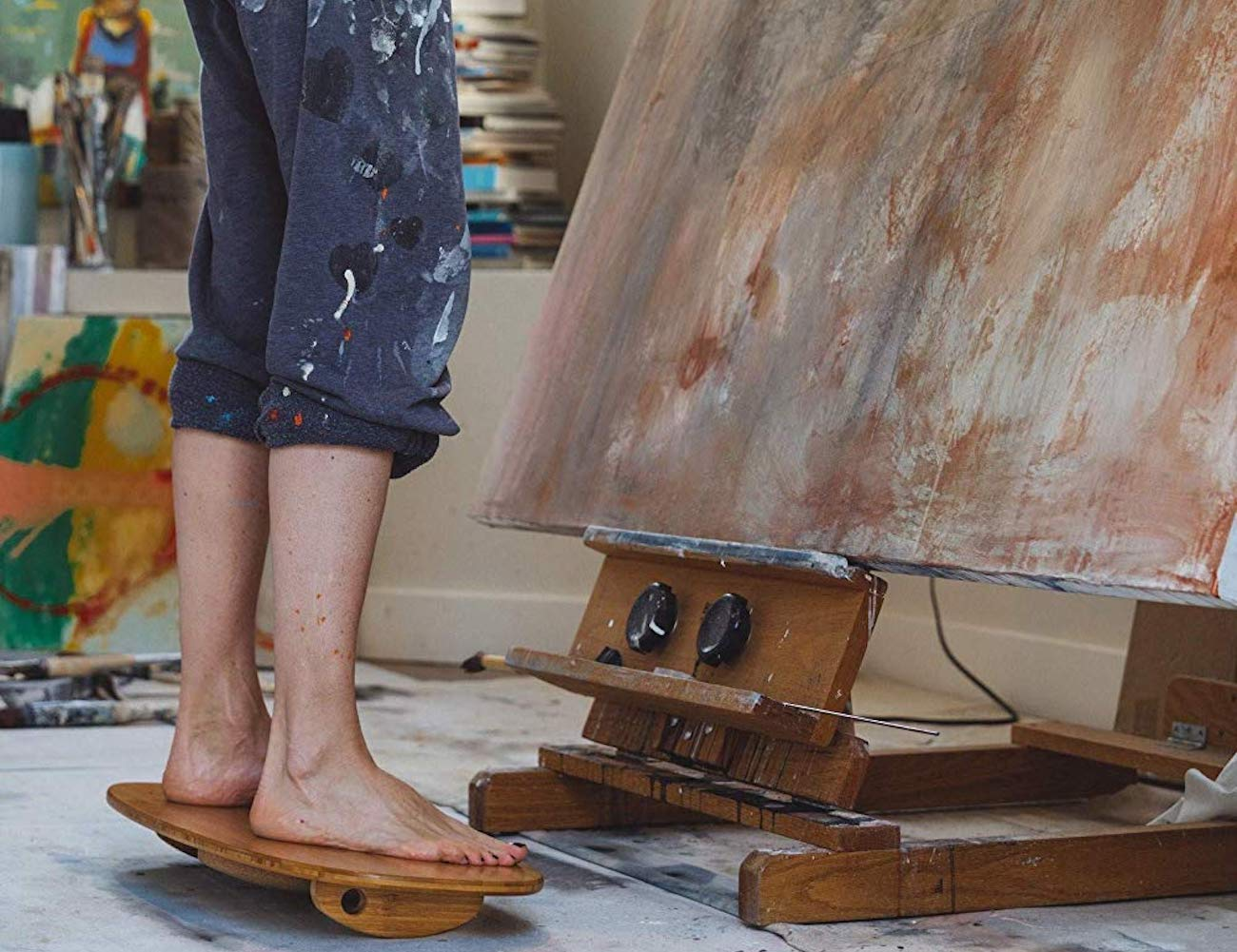 EBB + FLO Wooden Surfing Standing Desk Board will help you burn calories while you work