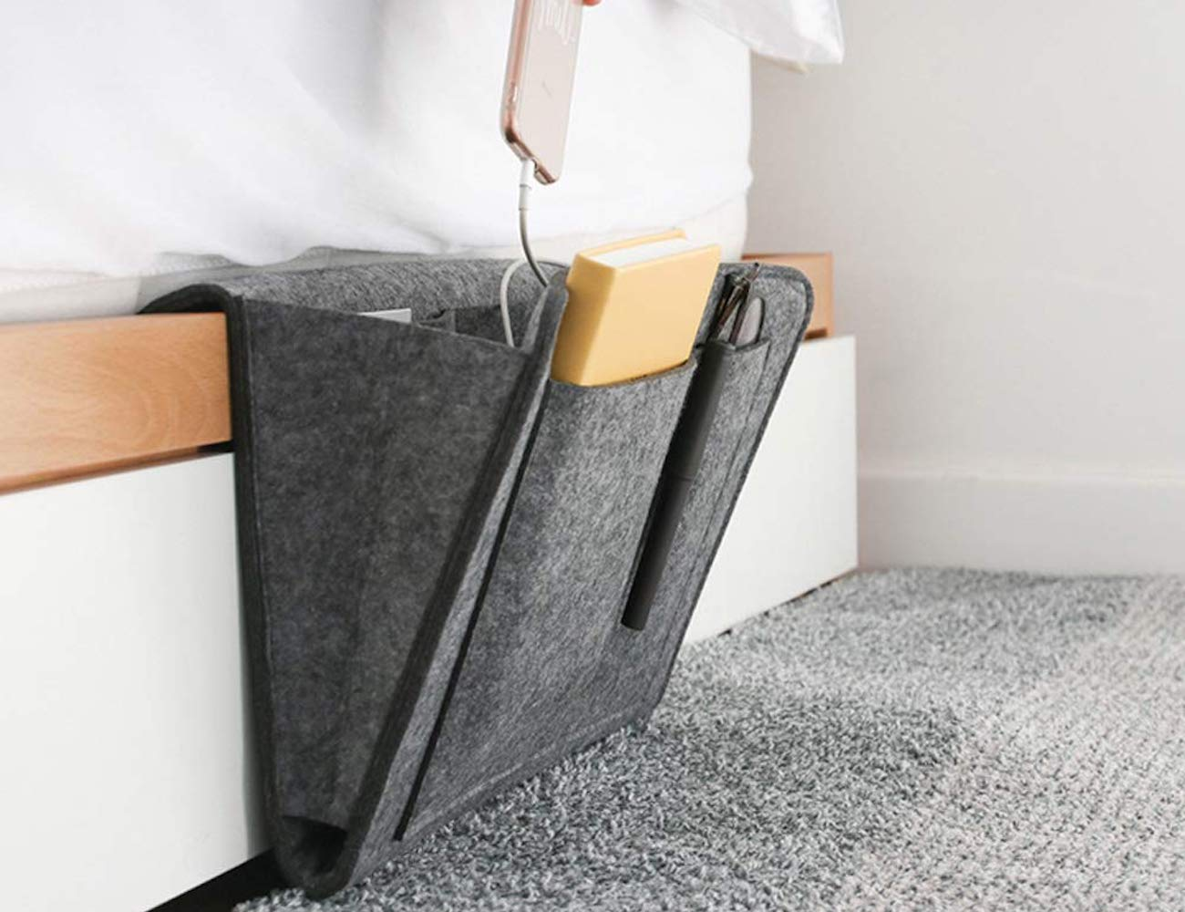 Lin-Tong Felt Bedside Organizer neatly stores all your often-used items