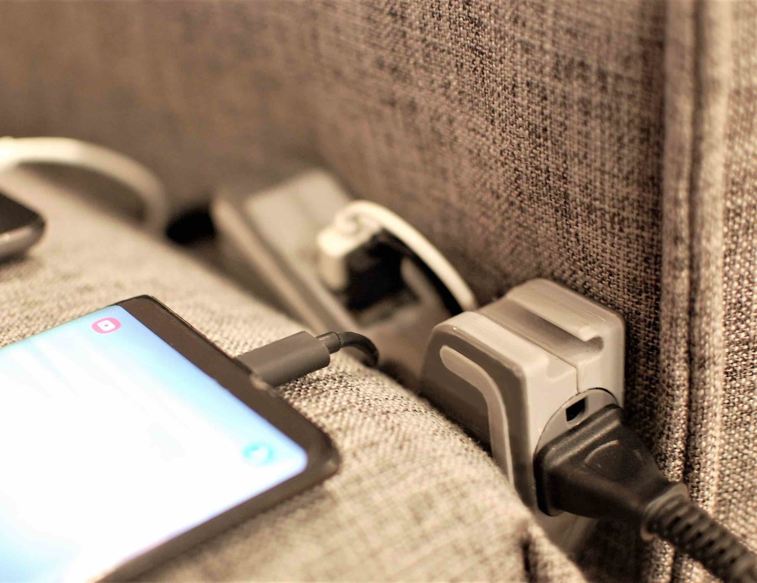 POWERFIN Sofa Extension Cord brings an outlet to your sofa