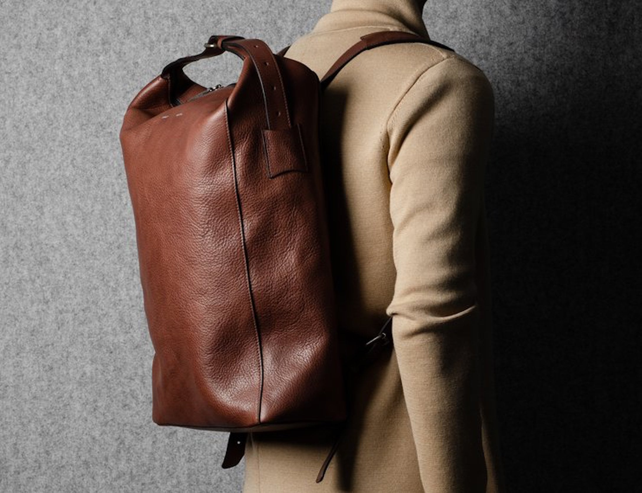 hardgraft Chestnut belted leather backpack has a padded laptop compartment