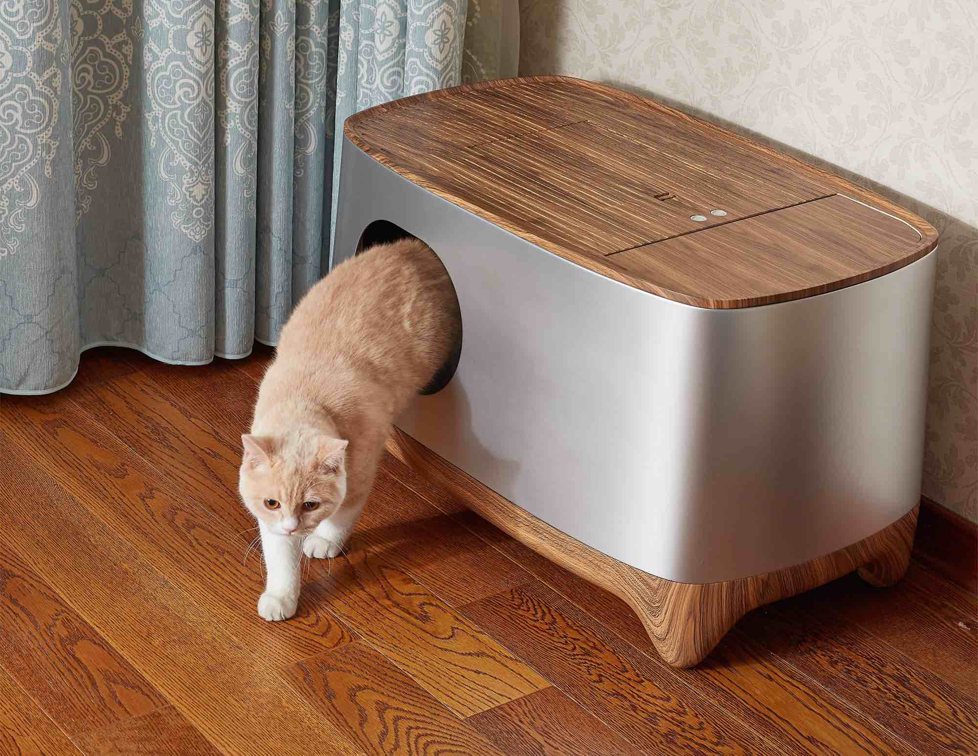 This Self Cleaning Litter Box Automatically Packs Pet Waste