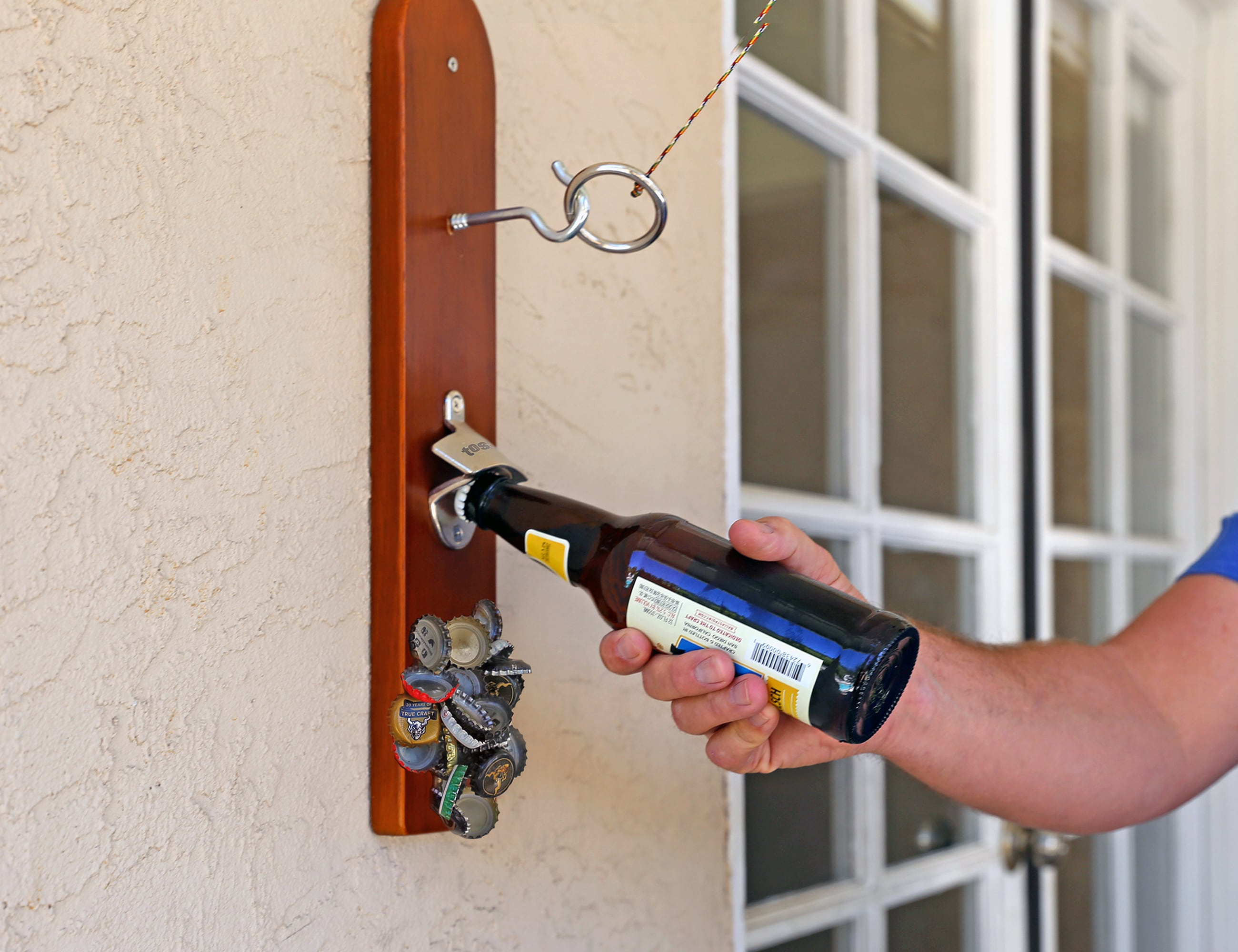 Hook and Ring Game Wall-Mounted Bottle Opener adds endless fun to your parties