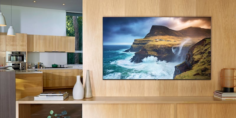 A TV with an ocean image on the screen in a living room.