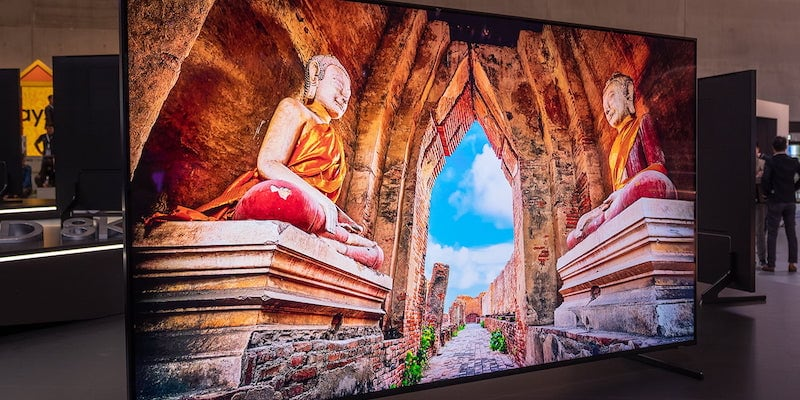 A TV has an image of Buddhist monk statues on it.