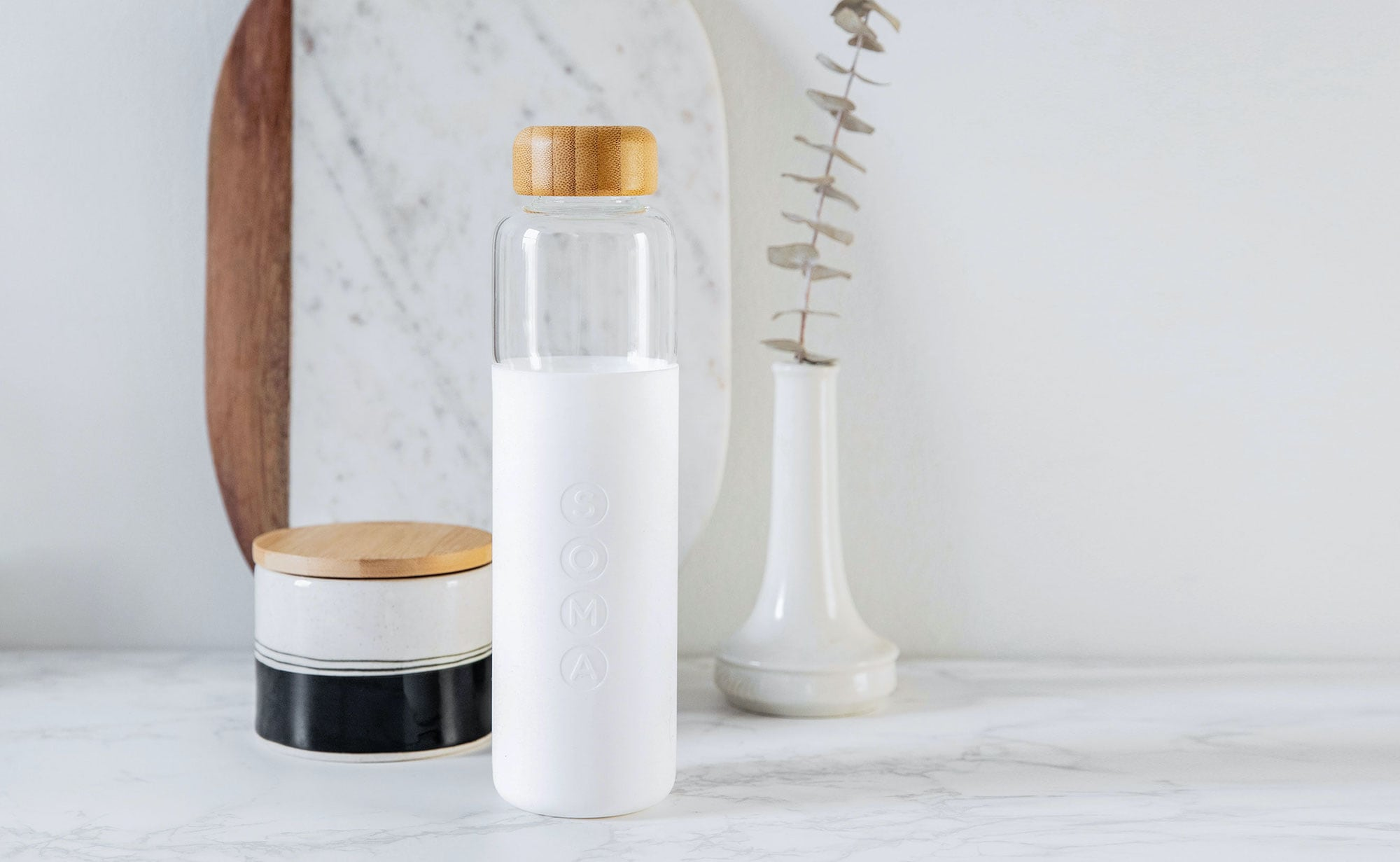 Soma Glass Water Bottle lets you take filtered water on the go