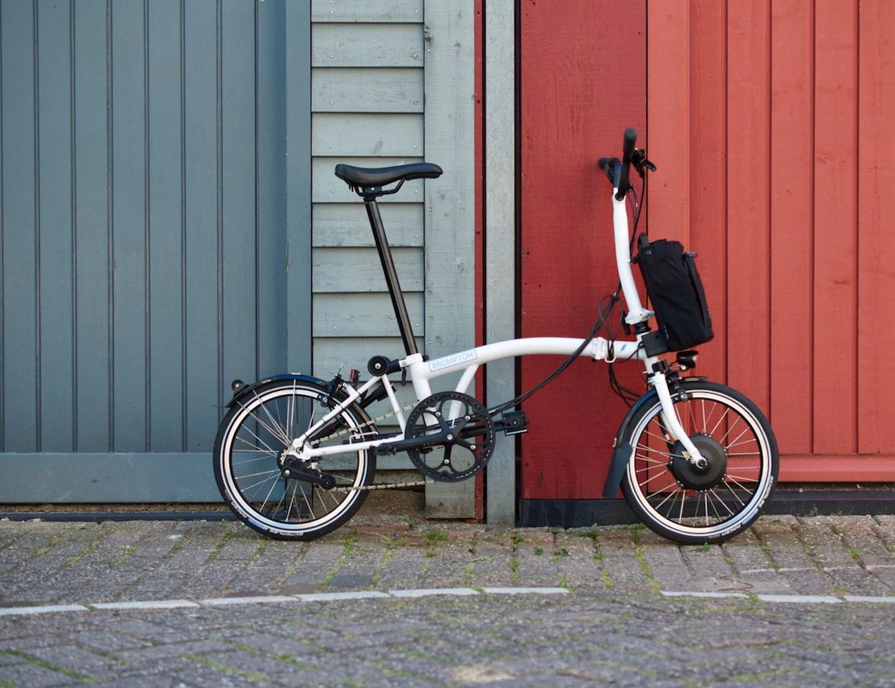 Brompton Electric Lightweight Compact Folding Bike collapses for easy portability