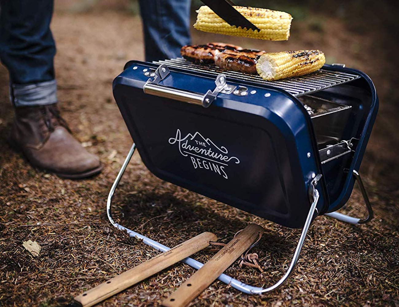 Gentlemen's Hardware Portable Barbecue Compact Coal Grill has a convenient carry handle