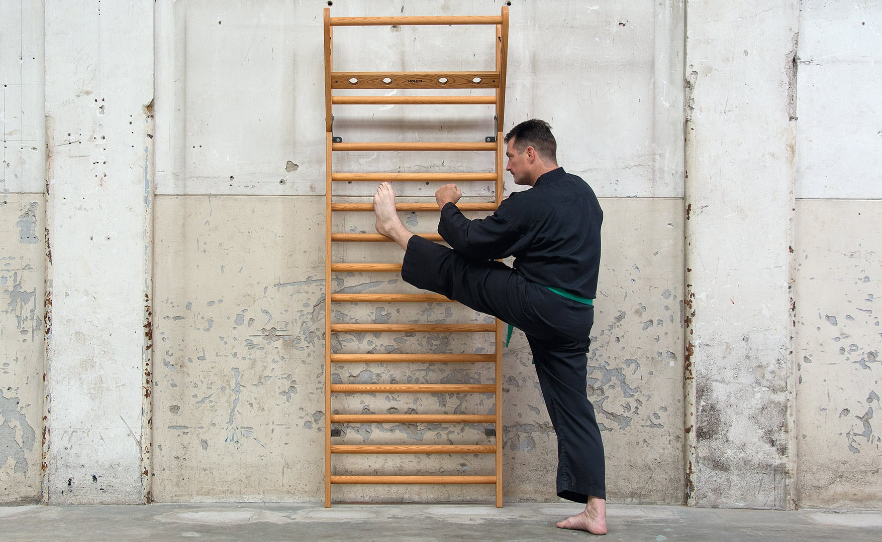 NOHrD WallBars Foldout Sports Equipment provides training and stretching options