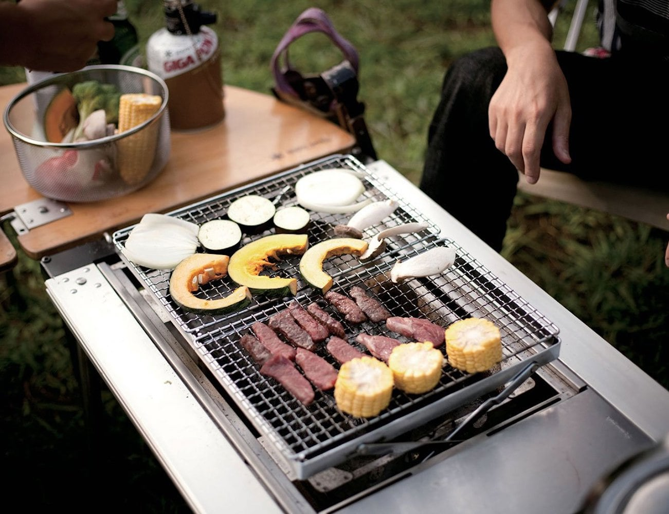 Snow Peak Double BBQ Box Iron Grill Table lets you grill right where you're eating