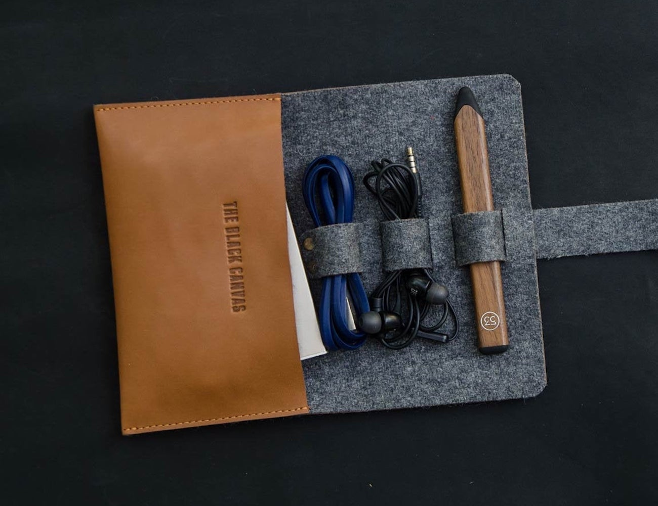 The Black Canvas leather & felt USB cable organizer makes for easy carrying