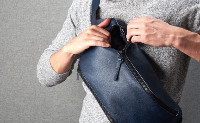 Leather Backpack sling bag conveniently carries your everyday items