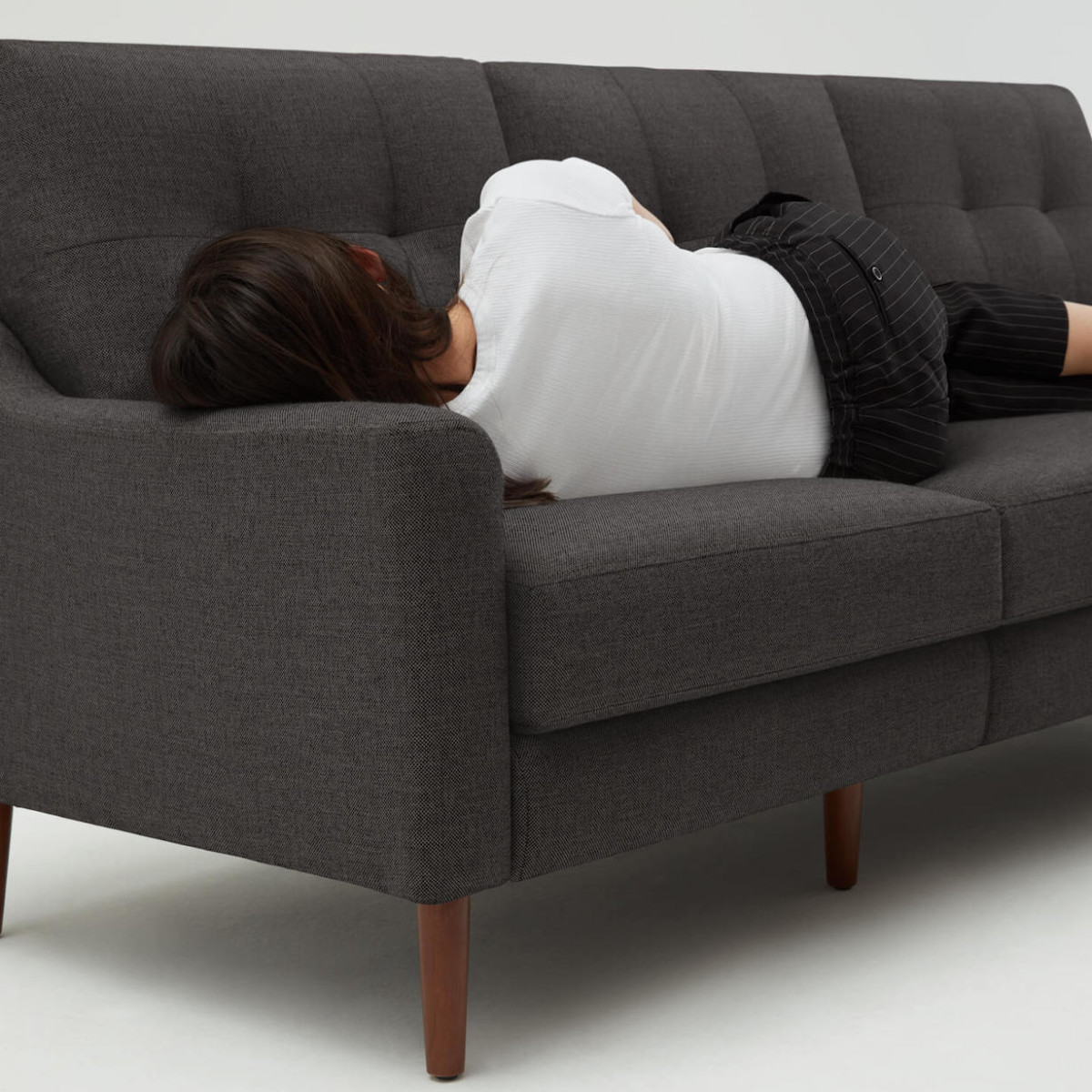 Burrow Nomad Sofa Modular Couch has a built-in USB charger and power cord