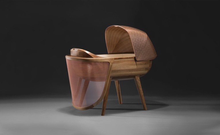 Ludwig & Dominique Argo Anti-Electromagnetic Wave Crib is handcrafted with walnut and copper