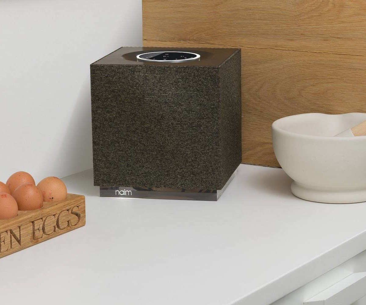Naim Audio Mu-so Qb 2nd Generation compact wireless speaker can enhance your TV's sound
