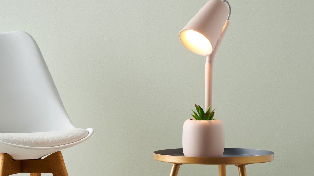 Suyo Table Light Utilitarian Lamp helps reduce clutter on your desk