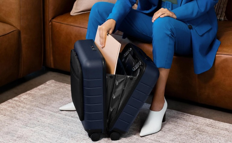 Away Daily Carry-On Compact Suitcase has a built-in front pocket for easy access