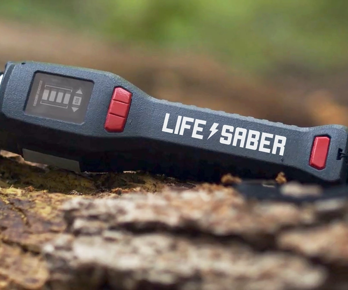 LIFESABER Wilderness Survival Power Supply has a snap-on water purifier and a built-in USB charger
