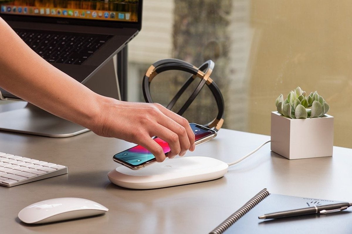 SanDisk iXpand Wireless Charger Photo Backup Device ensures your memories aren't lost