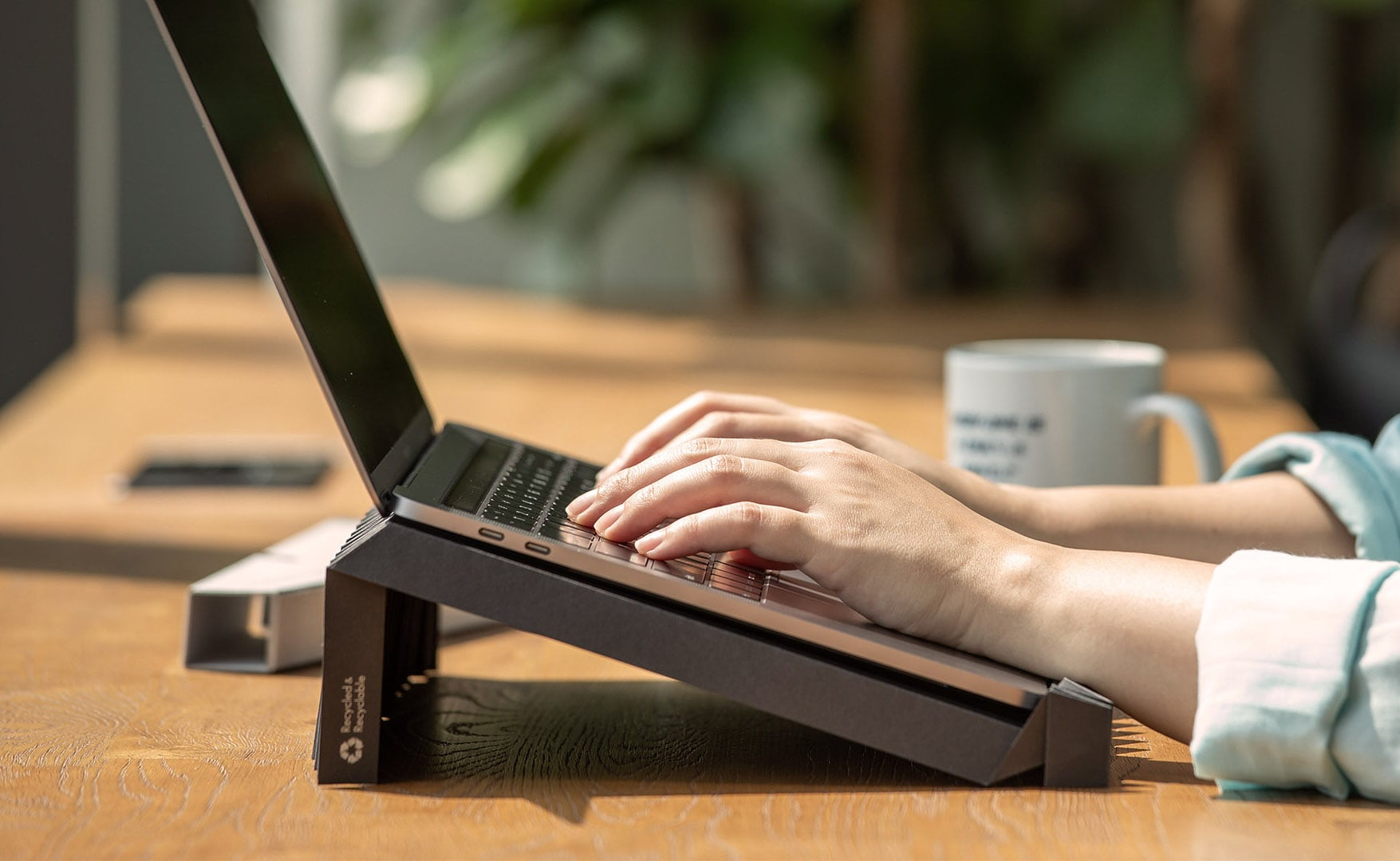 g.flow Portable Paper Laptop Stand is made from a single sheet of recycled paper