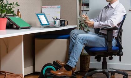 Person using Cubii Jr at desk