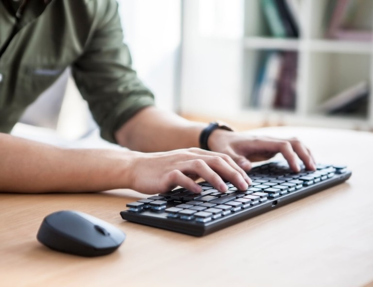 Person typing on Keychron